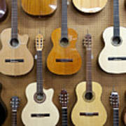Various Guitars Hanging From Wall Print by Lisa Romerein