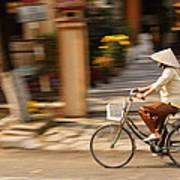Vietnamese Woman Riding A Bicycle Print by Panya Jampatong