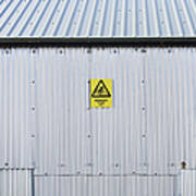 Warning Sign On An Industrial Building Print by Iain Sarjeant