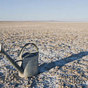 Water Pail On Dried Mud Print by Thom Gourley/Flatbread Images, LLC