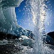 Water Splashes Over A Sheet Of Ice Print by Raymond Gehman