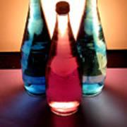 Electric Light Through Bottles Print by Caroline Peacock