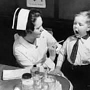 A Nurse Examining The Teeth Of A Boy Print by Everett