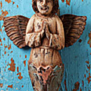 Angel On Blue Wooden Wall Print by Garry Gay