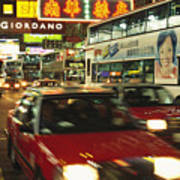 Kowloon Street Scene At Night With Neon Print by Justin Guariglia