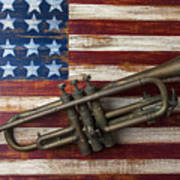 Old Trumpet On American Flag Print by Garry Gay