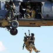 Pararescuemen Are Hoisted Into An Hh-60 Print by Stocktrek Images