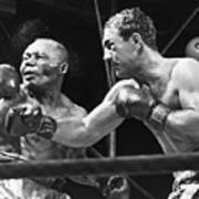 Rocky Marciano Landing A Punch Print by Everett