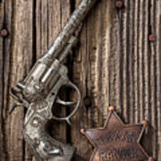 Toy Gun And Ranger Badge Print by Garry Gay