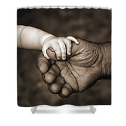 Babys Hand Holding On To Adult Hand Shower Curtain by Corey Hochachka