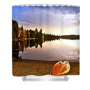 Lake sunset with canoe on beach Shower Curtain by Elena Elisseeva