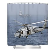 A Mh-60s Knighthawk Conducts A Vertical Shower Curtain by Gert Kromhout