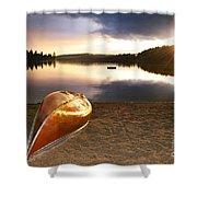 Lake sunset with canoe on beach Shower Curtain by Elena Elisseeva