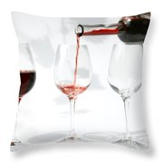 pouring red wine into glass Throw Pillow by Patricia Hofmeester