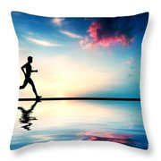 Silhouette Of Man Running At Sunset Throw Pillow by Michal Bednarek