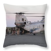 U.s. Marines Board A Ch-46 Sea Knight Throw Pillow by Stocktrek Images