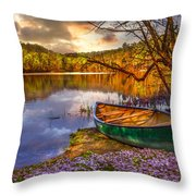 Canoe At The Lake Throw Pillow by Debra and Dave Vanderlaan