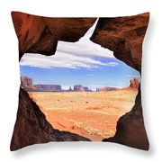 A Peek Into Monument Valley Throw Pillow by Sandra Bronstein