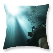 A Scuba Diver Surfacing And Looking Throw Pillow by Michael Wood