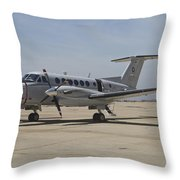 A U.s. Navy Uc-12w King Air Utility Throw Pillow by Timm Ziegenthaler