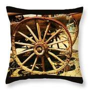 A Wagon Wheel Throw Pillow by Jeff Swan
