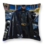 Batmobile And Batman Throw Pillow by Tommy Anderson