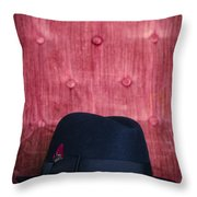 Black Hat On Red Velvet Chair Throw Pillow by Edward Fielding