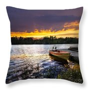 Boat on lake at sunset Throw Pillow by Elena Elisseeva