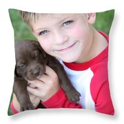 Boy Holding Puppy Throw Pillow by Colleen Cahill