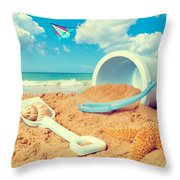 Bucket And Spade On Beach Throw Pillow by Amanda And Christopher Elwell