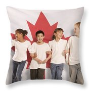 Children In Front Of Canadian Flag Throw Pillow by Don Hammond