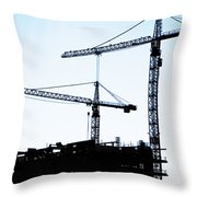 construction cranes Throw Pillow by Antony McAulay