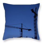 construction cranes at dusk Throw Pillow by Antony McAulay
