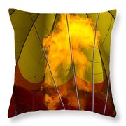 Flames heating up hot air balloon Throw Pillow by Garry Gay