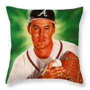 Greg Maddux Throw Pillow by Dick Bobnick