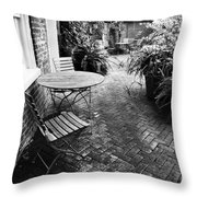 Into The Courtyard Throw Pillow by John Rizzuto