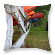 Kayaks On A Fence Throw Pillow by Michael Mooney