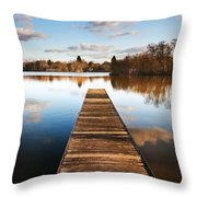 Landscape Of Fishing Jetty On Calm Lake At Sunset With Reflectio Throw Pillow by Matthew Gibson