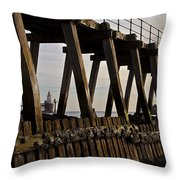 Lighthouse Through The Wooden Pier Throw Pillow by Jim Jones