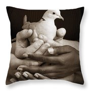 Many Hands Holding A Dove Throw Pillow by Ron Nickel