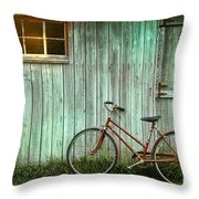 Old bicycle leaning against grungy barn Throw Pillow by Sandra Cunningham