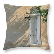 Old Door and Stucco Wall Throw Pillow by Olivier Le Queinec