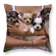 Puppies In Maria's Arms Throw Pillow by John Lautermilch