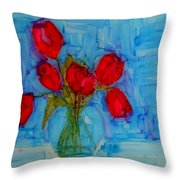 Red Tulips With Blue Background Throw Pillow by Patricia Awapara