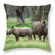 Rhino Family Throw Pillow by Sebastian Musial