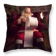 Santa Checking HIs List Throw Pillow by Diane Diederich