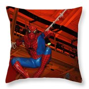 Spiderman Swinging Through The Air Throw Pillow by John Telfer