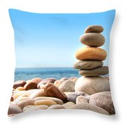 Stack of pebble stones on white Throw Pillow by Sandra Cunningham