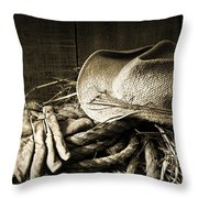 Straw hat with gloves on a bale of hay Throw Pillow by Sandra Cunningham