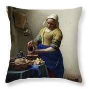 The Milkmaid Throw Pillow by Johannes Vermeer